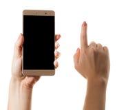 智能手机在一只女性手上 免版税库存照片