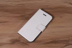 智能手机的盒在木背景 库存图片