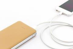 智能手机的黄色力量银行USB缆绳 免版税库存照片