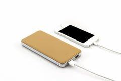 智能手机的黄色力量银行USB缆绳 免版税图库摄影
