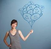 暂挂微笑的气球画的愉快的妇女 免版税库存图片