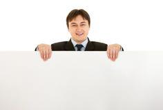 暂挂现代微笑的广告牌空白生意人 库存照片