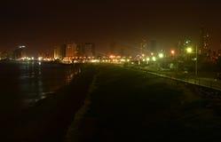 黑暗和轻的海滩路 库存图片