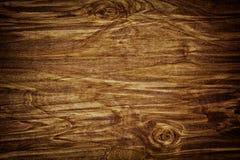 黑暗弄脏了,困厄的木台面厚木板纹理 免版税库存照片