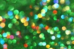 黑暗抽象绿色,红色,黄色,绿松石闪烁背景圣诞节树抽象背景 免版税库存照片