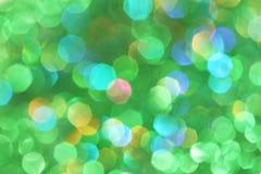 黑暗抽象绿色,红色,黄色,绿松石闪烁背景圣诞节树抽象背景 库存照片