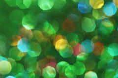 黑暗抽象绿色,红色,黄色,绿松石闪烁背景圣诞节树抽象背景 库存图片
