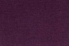 黑暗的伯根地,从纺织材料的紫色背景 与自然纹理的织品 靠山 免版税库存图片