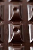 黑暗的巧克力表面  库存图片