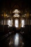 黑暗的教会走廊 库存照片