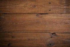 黑暗的木盘区背景 免版税库存照片
