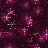 黑暗的桃红色雪花或星在黑暗的背景 免版税库存图片