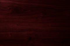 黑暗的樱桃木头纹理 库存照片