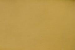 黑暗的沙子灰泥墙壁纹理背景 库存图片