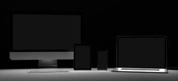黑暗的现代计算机膝上型计算机手机和片剂3D翻译 免版税库存图片