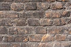 黑暗的砖墙纹理背景 免版税库存照片