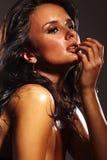 黑暗的背景的热的女孩 图库摄影