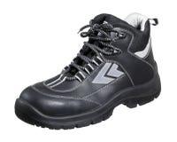 黑暗的运动鞋 免版税库存照片