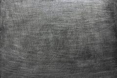 黑暗的金属背景,灰色从刷子的纹理钢污点 免版税库存照片