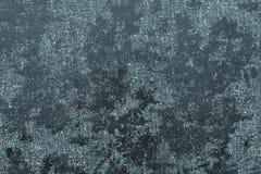 黑暗的靛蓝颜色抽象光滑的多斑点的纹理织品  库存照片
