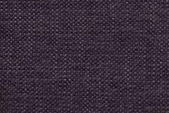 黑暗的紫罗兰编织了与软,羊毛状的布料的样式的羊毛背景 纺织品特写镜头纹理  免版税库存照片