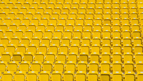 黑暗的黄色圆形剧场供以座位抽象背景 图库摄影
