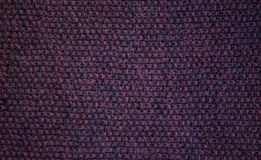 黑暗的紫色手工编织的背景 图库摄影