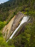 暗藏的Waterflall巴塔哥尼亚的埃尔博尔松阿根廷叫Cascad 库存照片