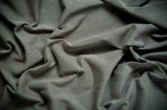 黑暗起皱纹的织品纹理 库存图片