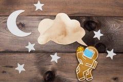 曲奇饼在空间题材的宇航员创造性  库存图片