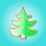 以曲奇饼的形式圣诞树绿色在蓝色背景 免版税图库摄影