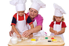 曲奇饼祖母孩子如何做教学 免版税图库摄影
