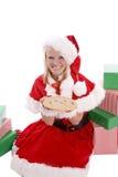 曲奇饼辅助工存在圣诞老人 免版税库存照片