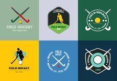 曲棍球商标集合 导航与人剪影、棍子和曲棍球球的体育徽章 库存照片