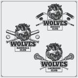曲棍网兜球、棒球和曲棍球商标和标签 与狼头的体育俱乐部象征  免版税库存照片