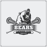 曲棍网兜球与熊头的俱乐部象征  免版税库存图片