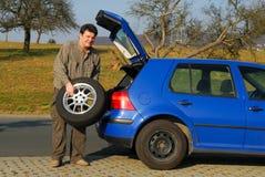 更改的人轮胎 库存图片