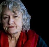 更老的皱眉头的妇女 免版税库存图片