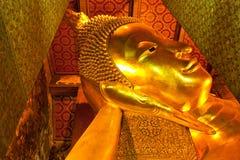 曼谷菩萨pho斜倚的泰国wat 免版税库存照片