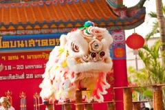 曼谷, /THAILAND 1月20日: 穿戴在春节庆祝的游行期间的舞狮在2013年1月20日 库存图片