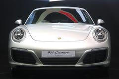 曼谷- 3月31 :在白色汽车的保时捷911 carrera在2016年3月31日的第37个曼谷国际泰国汽车展示会2016年 免版税库存图片