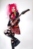 替代方式女孩吉他使用 库存照片