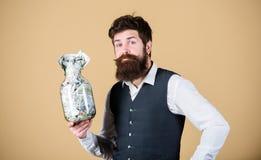 最佳的金钱投资 行家有美国金钱的藏品瓶子 保留金钱的有胡子的人在玻璃瓶子 ?? 库存照片