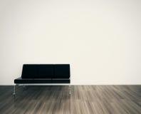 最小的现代内部长沙发表面死墙 库存照片