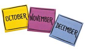 10月、11月和12月在稠粘的笔记 免版税库存图片