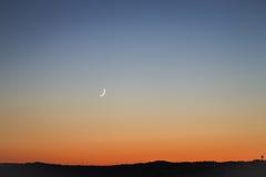 月亮新的日落 库存图片