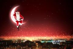 在月亮的圣诞老人 免版税库存图片