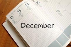12月在笔记本的文本概念 图库摄影