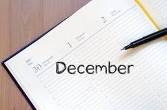 12月在笔记本的文本概念 库存图片