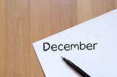 12月在笔记本的文本概念 库存照片
